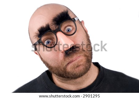 Man wearing fake nose and glasses with mustashe and eyebrows over a white background