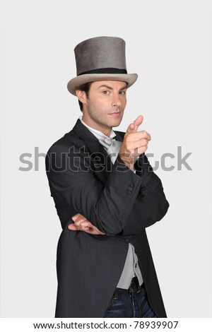 Man wearing hat and tailcoat