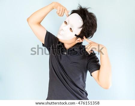 Man wearing mask acting clown