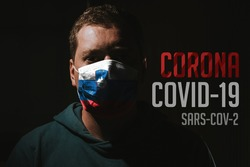 man wearing mask with flag of Slovenia for protection of corona virus covid-19 SARS-CoV-2