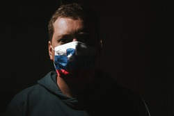 man wearing mask with Slovenia flag for protection of corona virus covid-19 SARS-CoV-2