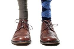Man Wearing Mismatched Dress Socks