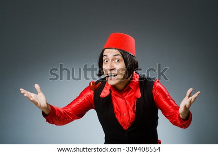 Man wearing traditional turkish hat fez Images and Stock Photos