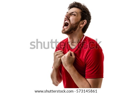 Man wearing red uniform celebrates on white background #573145861