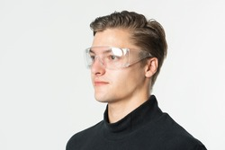 Man wearing transparent safety goggles