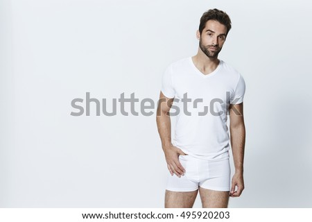Man wearing white t-shirt and underpants, studio