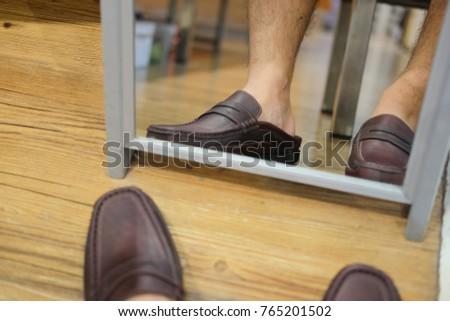 Man wears a classic leather shoe in shoe store #765201502
