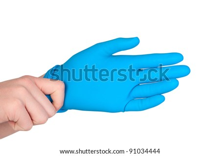 Man wears rubber glove on his hand.