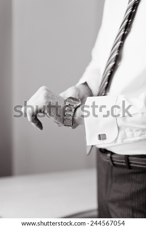 Man wears watches. Preparation for an important event