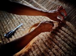 Man weaving abaca fibers in Albay
