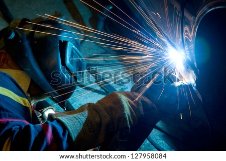 Man welding a car