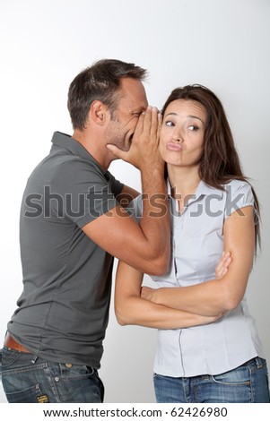 Man whispering to his girlfriend ear