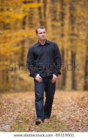 Man who was walking through the woods in autumn