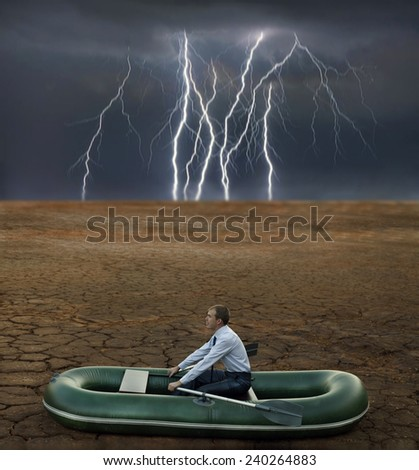 man will rows home for shore in paddle powered row boat businessman in boat rocks looks bright future symbol crisis stagnation losses braking difficulties environmental disaster water scarcity drought