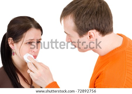 man wipes a tear from a woman with a handkerchief