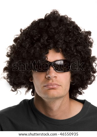 Man with a black curly wig and sunglasses