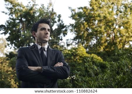 Man with a black suit on a park