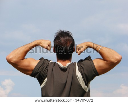 Man with a body builder on the background sky