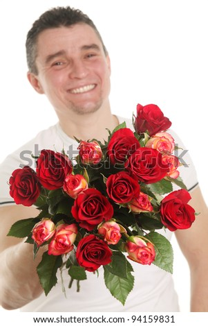 Man with a bouquet of red roses isolated on white background