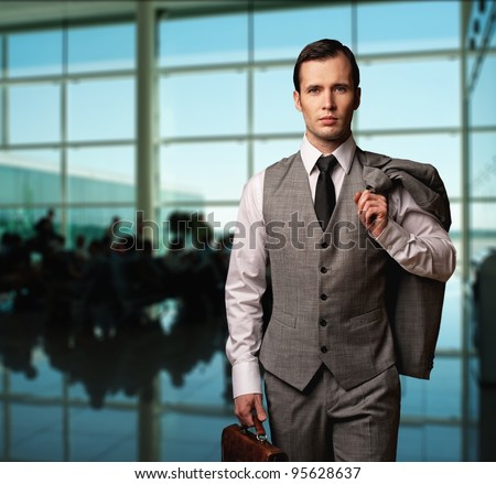 Man with a briefcase in an airport. - stock photo
