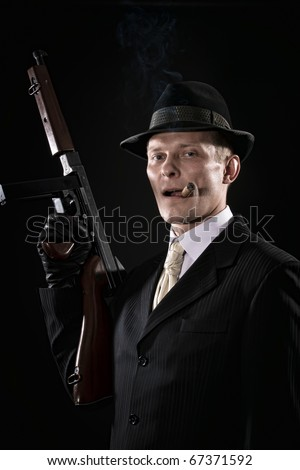 Man with a cigar  like a chicago gangster with submachine gun
