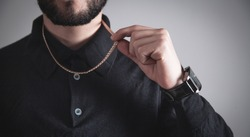 Man with a expensive necklace. Fashion accessories and jewelry