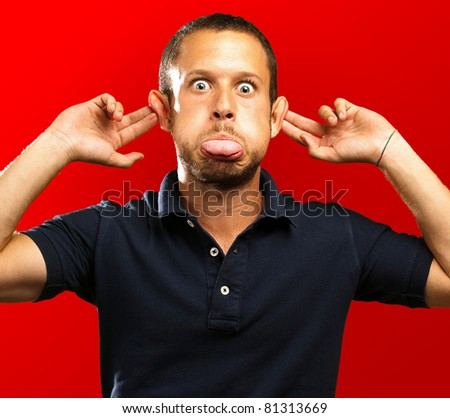 man with a funny face on a red background