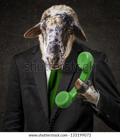 Man With A Goat Head Holding Telephone Receiver