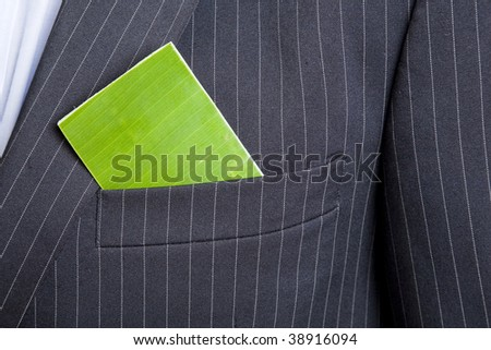 Man with a green business card in his suit pocket