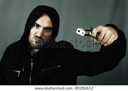 man with a gun and special photographic processing