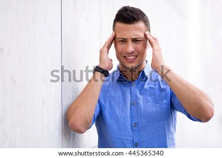 Man with a headache  #445365340