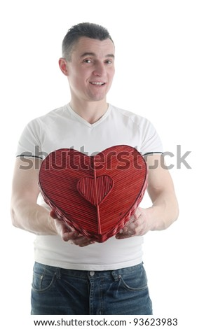 Man with a heart shaped box isolated on white background