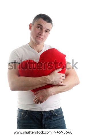 Man with a heart shaped pillow isolated on white background