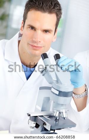 Man with a microscope in laboratory