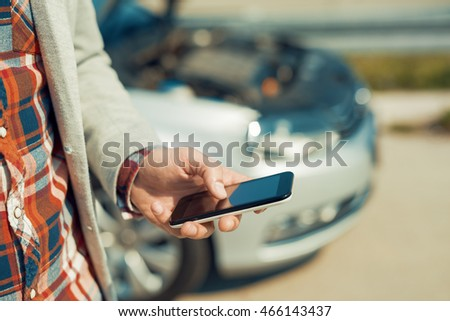 Man with a silver car that broke down on the road.He is waiting for the technician to arrive. #466143437