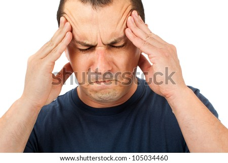 Man with a strong headache isolated on white background - stock photo