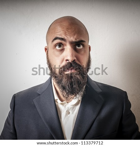 man with a suit and beard and strange expressions on white background