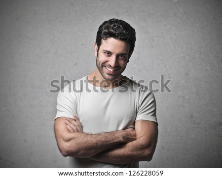 Man with a white shirt laughing