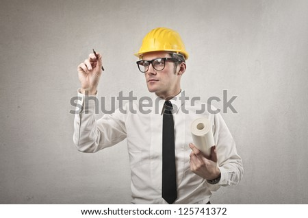 Man with a yellow helmet gives a command to someone