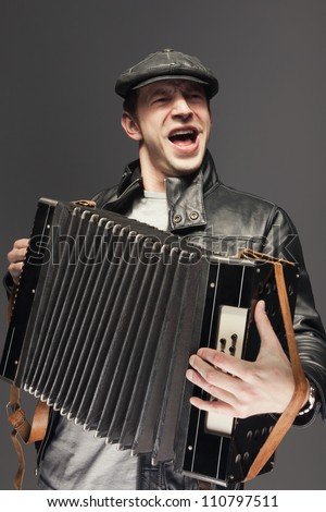 Man with accordion. Man is singing songs and playing the old accordion