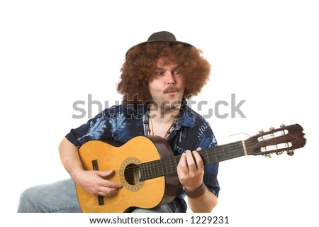 Man with afro hair and guitar