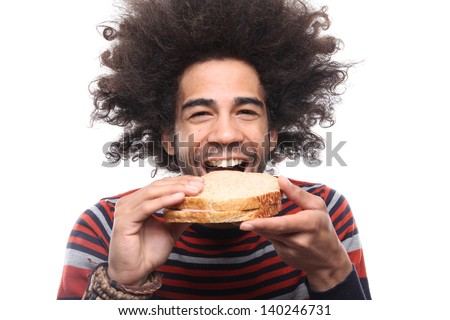 Man with an afro eating a sandwich