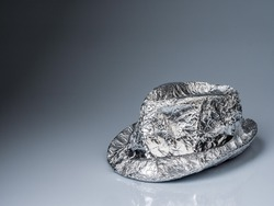 man with an aluminum hat. icon for troublemaker