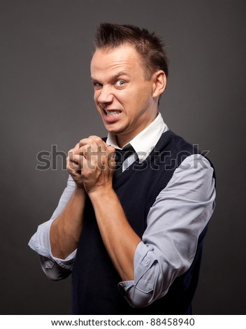 man with an angry threatening or disgusted look on his face
