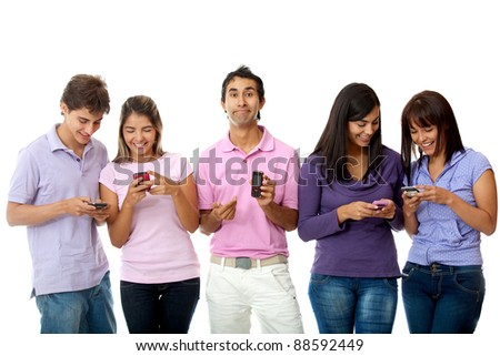 Man with an outdated cell phone while his friends chat on theirs - isolated