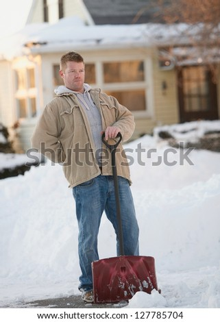 Man with back pain from shoveling snow