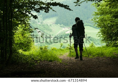 Man with backpack hiking in mountains, Travel lifestyle success concept adventure active vacations outdoor landscape. Go green concept. Leisure activity. Copy space. Place for text. Horizontal.