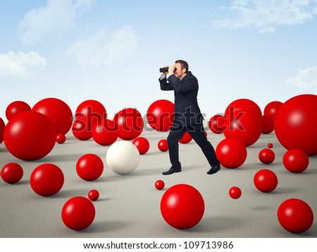 man with binoculars and 3d red balls world