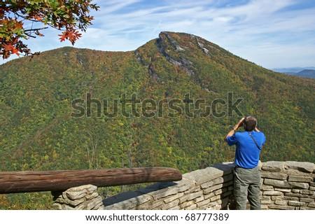 Man With Binoculars Enjoying A View Of Hawksbill Mountain From Wiseman's View Horizontal