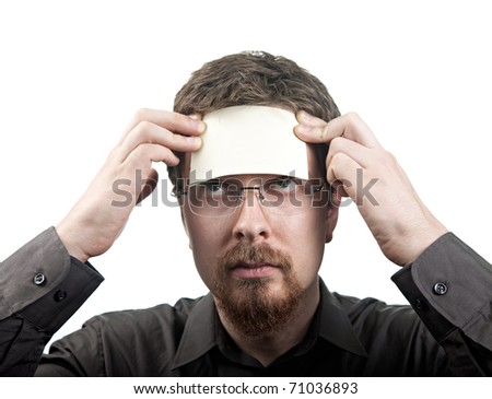 Man with blank note over his forehead isolated on white